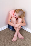 Sad teen sitting in corner Royalty Free Stock Image
