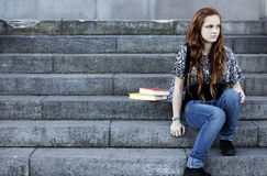 Sad teen student. Sitting with books Royalty Free Stock Images
