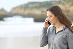 Sad teen talking on the phone Royalty Free Stock Photos