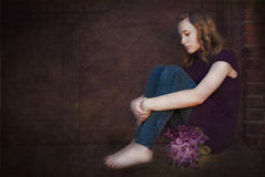 Sad teen with violet bouquet Royalty Free Stock Image