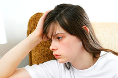 Sad teenage girl. In home interior Royalty Free Stock Image
