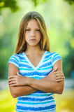Sad teenage girl in blue blouse Royalty Free Stock Photography