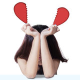Sad teenage girl with broken heart Stock Images
