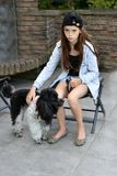 Sad teenage girl is comforted by her little poodle dog royalty free stock photos