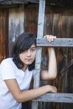 Sad teenage girl on the farm during the holidays. Sorrow. Royalty Free Stock Image