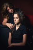 Sad teenage girl and her  worried mother Stock Image