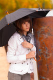 Sad teenage girl holds umbrella outdoor Royalty Free Stock Images