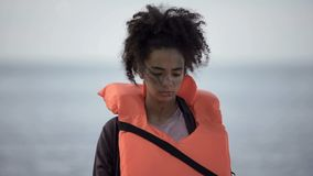 Free Sad Teenage Girl In Life Jacket Looking Distressed And Lonely, Disaster Victim Stock Image - 161877771