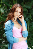 Sad teenage girl. Outdoor portrait of a sad teenage girl looking thoughtful about troubles royalty free stock photo