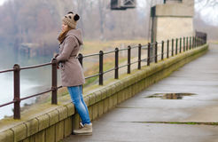 Sad teenage girl standing outside on cold winter day Royalty Free Stock Photography
