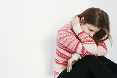 Sad teenage girl staying on her bed Royalty Free Stock Images