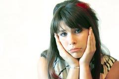 Sad teenage girl on white. A sad, teenage girl on white background stock images