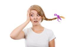 Sad teenage girl in windblown braid hair Royalty Free Stock Photos