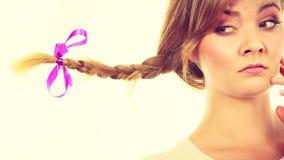 Sad teenage girl in windblown braid hair Stock Images