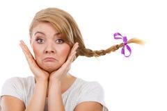 Sad teenage girl in windblown braid hair Stock Photo