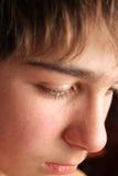 Sad teenager. Sad boy face close up Royalty Free Stock Photography