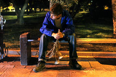 Sad teenager. Teenager in the night park with a flowers get break an appointmant Royalty Free Stock Images