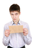 Sad Teenager with Blank Cardboard Royalty Free Stock Photography