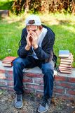 Sad Teenager with a Books Stock Images