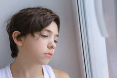 Sad teenager boy close up portrait Stock Photos