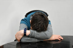 Sad teenager boy. Depressed teenage boy covers his head with his arms Royalty Free Stock Image