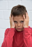 Sad teenager boy. After getting bad news Royalty Free Stock Images