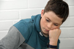 Sad teenager boy. Portrait of a depressed teenage boy Royalty Free Stock Image