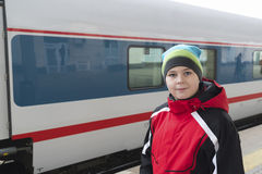Sad teenager boy standing near train Stock Images