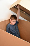 Sad teenager boy. Sad boy  wants to be alone, hides  in a cardboard box Stock Images