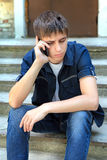 Sad Teenager with Cellphone Royalty Free Stock Image