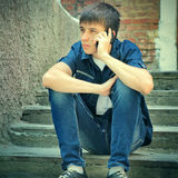 Sad Teenager with Cellphone Royalty Free Stock Images