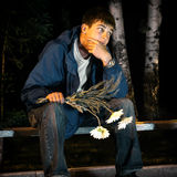 Sad Teenager with Flowers Stock Photos