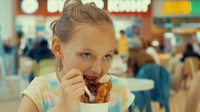 Sad teenager girl eating chocolate ice cream in cafe. Young girl teenager eating ice cream dessert with waffle in stock footage