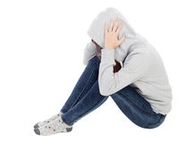 Sad teenager girl with gray sweatshirt hooded. Isolated on white background royalty free stock photos