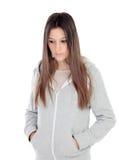 Sad teenager girl with gray sweatshirt. Isolated on white background Stock Images