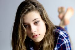 Sad teenager looking away feeling strong emotion Stock Photo