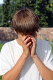 Sad Teenager Outdoor. Sad Teenager close his Face in the Summer Park Royalty Free Stock Photography
