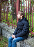 Sad Teenager outdoor. Pensive Teenager Portrait on the City Street Stock Photo
