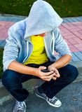 Sad Teenager outdoor. Sad Teenager sit on the City Street Stock Photos