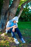 Sad Teenager outdoor. Sad Teenager under the Tree in the Park Royalty Free Stock Photo