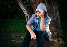 Sad Teenager outdoor. Sad Teenager under the Tree in the Park Stock Photography