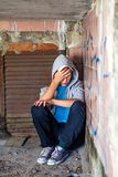 Sad Teenager outdoor. Sad Teenager sit in the Corner of the Old Building Royalty Free Stock Photo