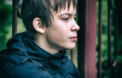 Sad Teenager outdoor. Toned Photo of Pensive Kid Portrait closeup on the City Street royalty free stock photo
