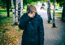 Sad Teenager outdoor. Toned Photo of Sad Teenager stand in the Autumn Park stock image