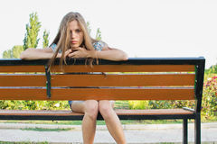 Sad teenager on park bench Royalty Free Stock Image