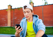 Sad Teenager with a Phone Royalty Free Stock Photos