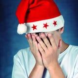 Sad Teenager in Santa Hat Stock Images