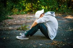 Sad Teenager outdoor. Sad Teenager sit on the Ground outdoor Stock Photo