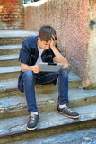 Sad Teenager with Tablet Computer Stock Photo