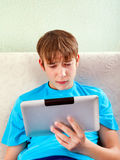 Sad Teenager with a Tablet Royalty Free Stock Images